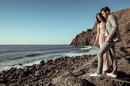 Elegant, young lovers watching ocean's waves Reklamní fotografie - 93860139