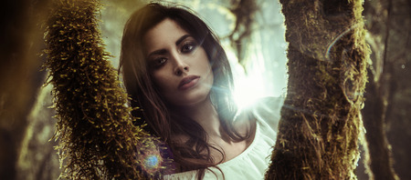 Portrait of a beautiful woman posing among trees Archivio Fotografico
