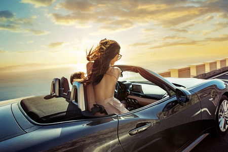 Relaxed, young couple riding a convertible