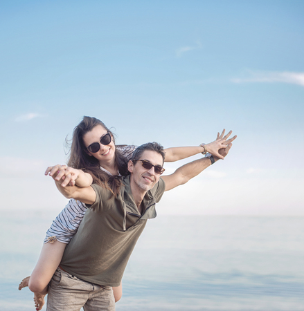 Conceptual portrait of a young, cheerful married couple on vacation