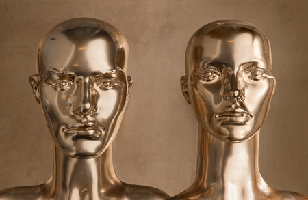 Two heads of human golden scupltures
