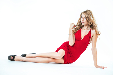 Portrait of a woman wearing a red dress - isolated Stock Photo