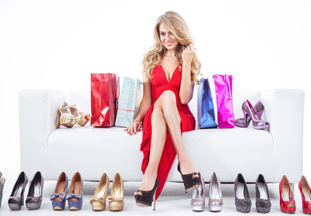Fashionable woman with lots of colorful shoes