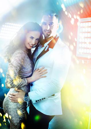Cheerful, elegant couple in the nightclub