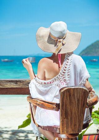 Calm lady relaxing in a summer beach bar Stock Photo