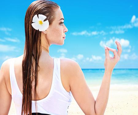 Pretty woman on a tropical beach
