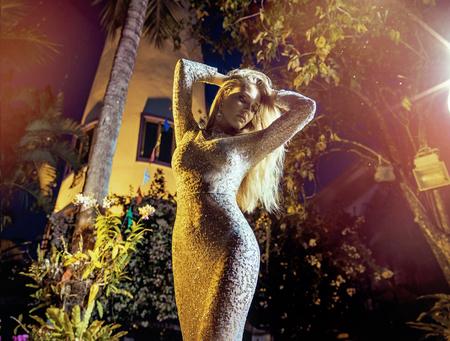 Portrait of an elegant, sensual woman wearing a peral dress