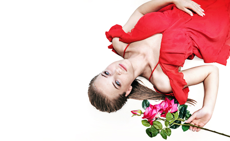 Pretty blond woman holding a rose - isolated portrait Stock Photo