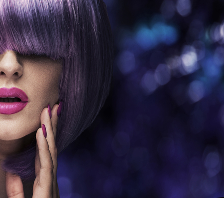 Fashion shot of a pretty woman wearing a purple wig Stock Photo