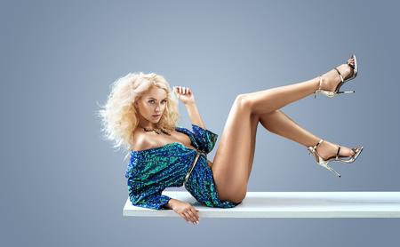 Sensual, half-nude woman wearing shining dress Reklamní fotografie - 111766898