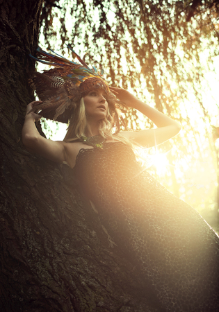 Art portrait of a blond nymph posing in the autumnal park Stock Photo - 112895592