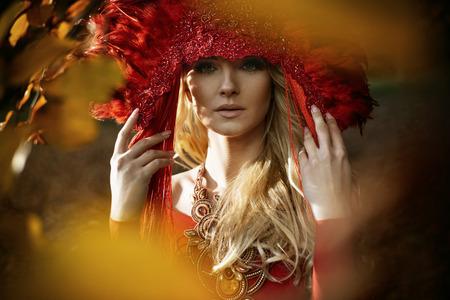 Beautiful blond woman wearing a red, elegant coronet Stock Photo