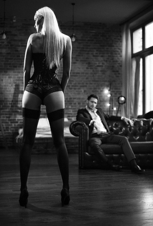 Handsome businessman looking at the sensual woman wearing sexy lingerie