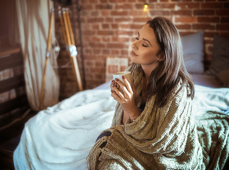 Portrait of a relaxed woman drinking coffee