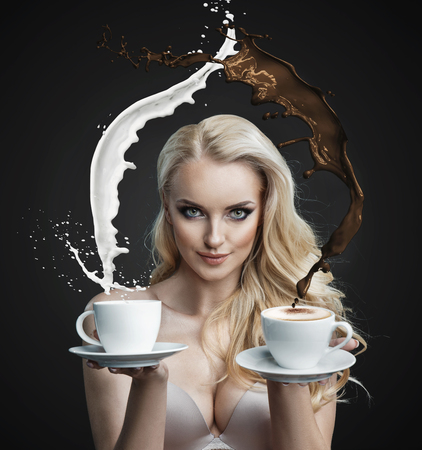 Portrait of a beautiful blond lady holding making a coffee hurricane Banco de Imagens