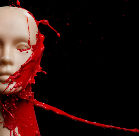 Mannequin splashed with deep red paint