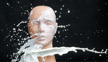 Mannequin splashed with pure white paint Banco de Imagens