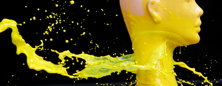 Mannequin splashed with bright yellow paint Imagens - 119077471