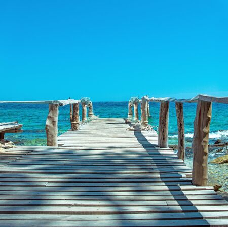 Old, wooden pier on a tropical, asian beach