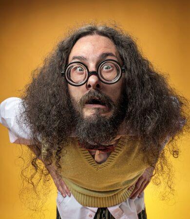 Closeup portrait of a funny, skinny geek staring at the camera Stock fotó
