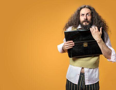 Portrait of the surprise nerd holding a briefcase