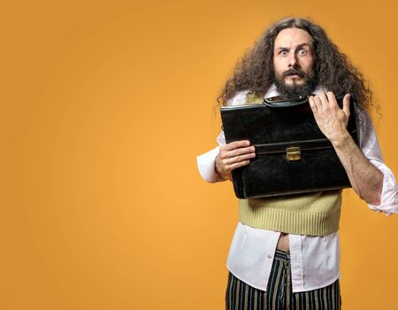 Portrait of the surprise nerd holding a briefcase
