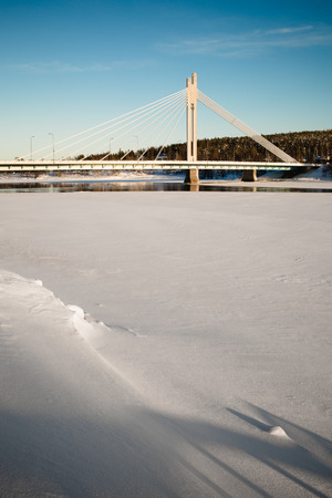 rovaniemi: The Jatkankynttila bridge over frozen Kemijoki river in Rovaniemi, Finland.