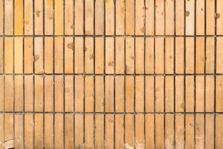 tile cladding: Orange tile cladding on exterior of old apartment house in Warsaw, Poland.
