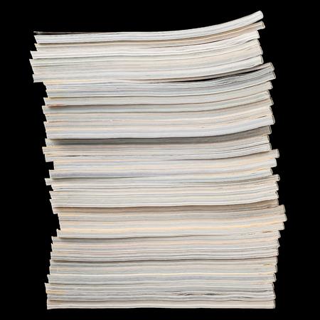 magazine stack: Stack of magazine isolated on black background.