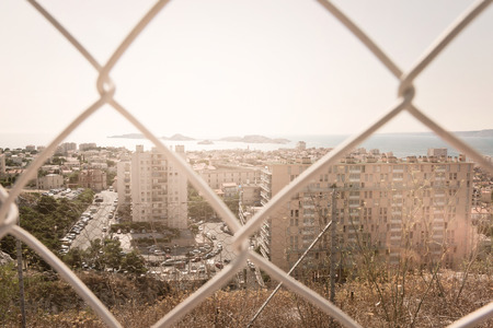 suburbs: View of Marseille residential suburbs through wire fence, France. Stock Photo