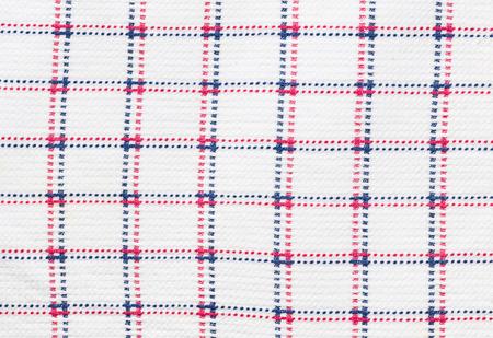 imbalance: Close-up of checkered kitchen cloth.