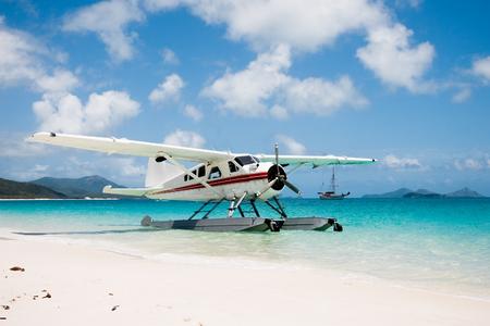 whitehaven beach: Seaplane on Whitehaven Beach in Queensland, Australia.