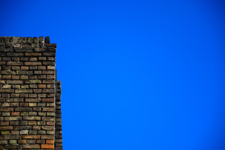 Old brick wall on a background of blue sky photo