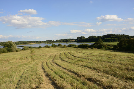 fields and meadows: Classic Polish countryside, fields, meadows, lakes, hills, ponds, windmills. Foto de archivo