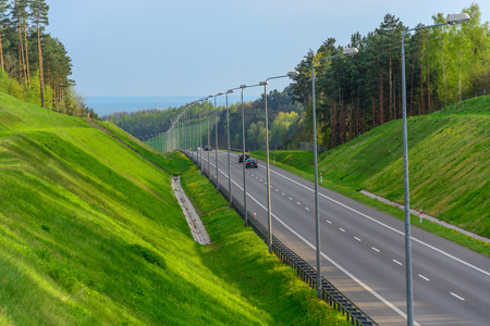 Image of busy modern highway in the green gorge Standard-Bild