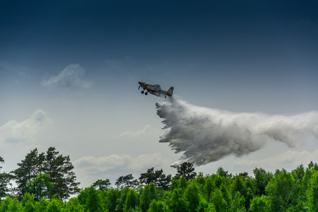 extinguish: flying fireman, a small forest fire-fighting aircraft Stock Photo