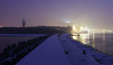 Swinoujscie harbor in the winter at night