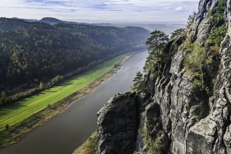 View from the viewpoint from the Bastei bridge on the river Elba. Saxon Switzerland National Park in autumn