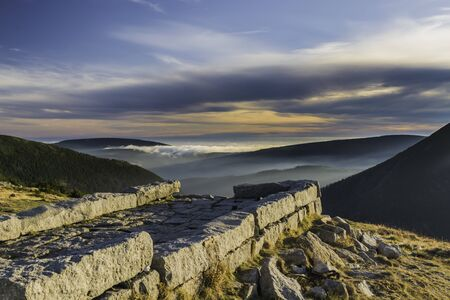 Karkonosze National Park, a beautiful view of the fog and clouds in the setting sun
