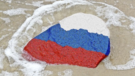 neighbouring: Flag of Russia on a stone on the Baltic Sea beach