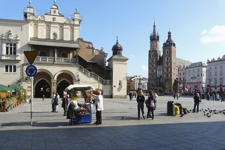 Market place with cloth hall and St. Marys church in Krakow in Poland photo