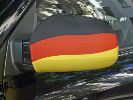Side mirror in black-red-and-gold at a car photo