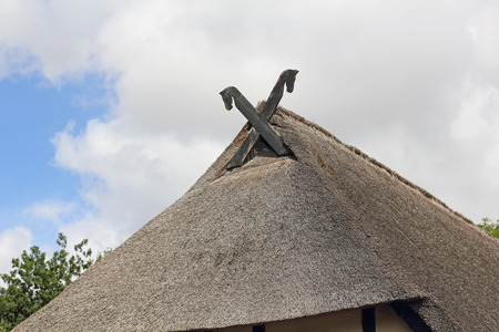 bordered: The thatched roof of the Low German hall houses is bordered traditionally with wooden soffits in form of a horse head