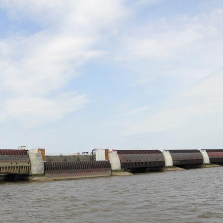 lift lock: Landward side of the Eider Barrage at the German North sea coast