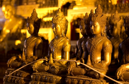 The bronze statues of Buddha in Wat Jedi Luang at Chiang mai photo
