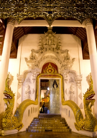 Gate of Buddhist temple with two Naga s heads in Wat Jedi Luang at Chiang mai photo