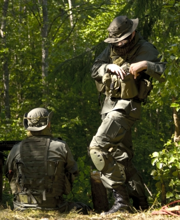 flak: Two American soldiers in the military form are in wood Stock Photo