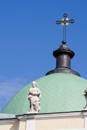 tiled cupola of church with sculpture cross statue photo