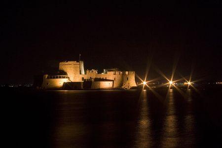 bourtzi: night view on bourtzi castle in nafplio greece Stock Photo