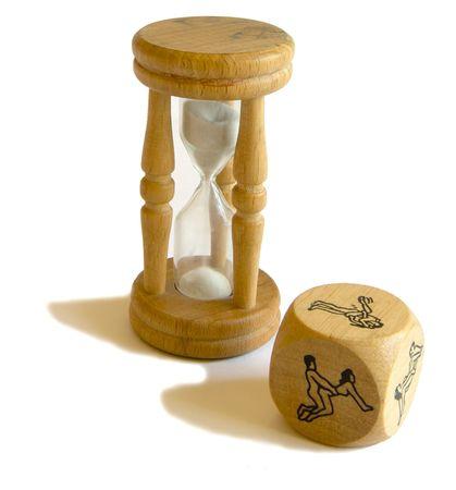 kamasutra: gambling in kamasutra - hourglass and dice with kamasutra positions Stock Photo
